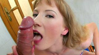 Sweet perfect golden haired is licking this hard boner all over
