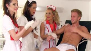 Four expensive nurses taking care about physically strong patient