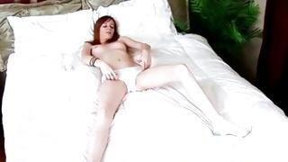 Skinny long legged beauty is stimulating her pussy hard core